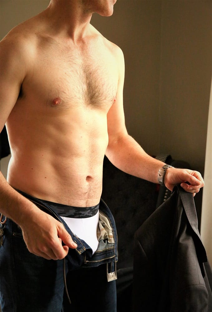Photo of Harley Brixton male escort's body, pants unzipped.